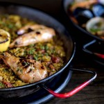 Paella with grilled prawns and lemon