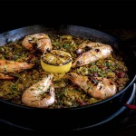 Paella with charred lemon and head-on prawns